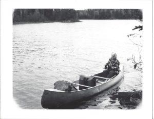Dorothy solo-paddling a canoe