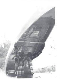 Dorothy Molter Portaging an aluminum canoe