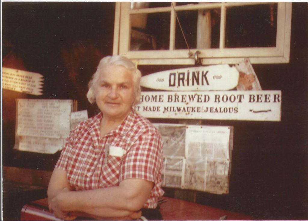 Dorothy standing in front a brewing station in her museum.