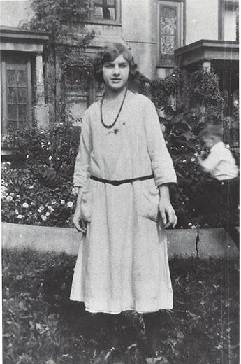 College age Dorothy on a school break in 1930 standing outside.